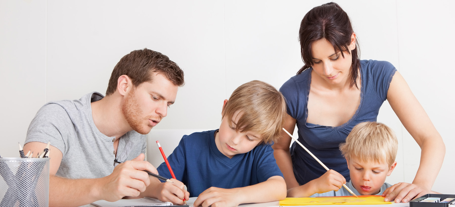 Parents working with their two children