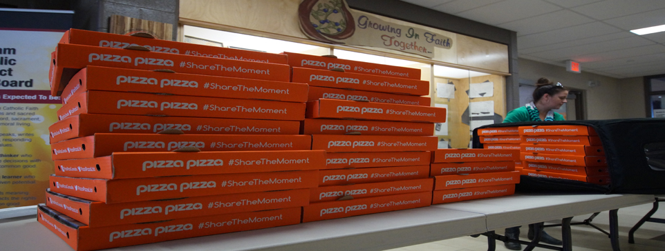 Stacks of pizza boxes.